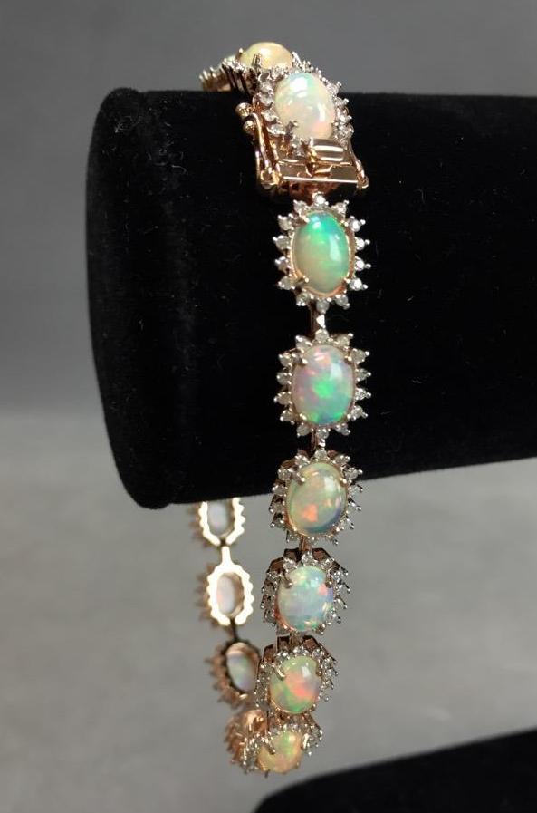 14k Gold Opal and Diamond bracelet (9.10ctw opal 1.39ctw diamonds) w/ $8,825.00 A.I.G. appraisal.