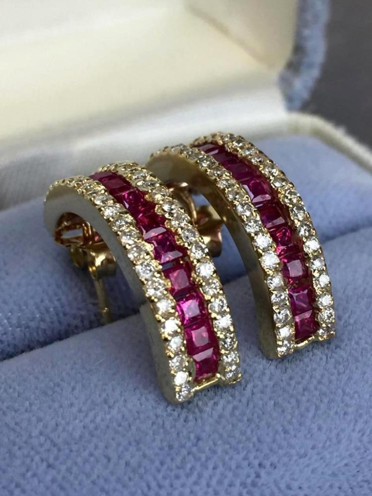 14k Gold arched Ruby and Diamond earrings (1.83cts rubies .86ctw diamonds) w/ $5,850.00 A.I.G. appraisal.