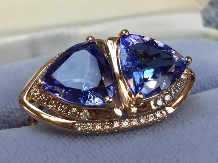 14k Twin Tanzanite & Diamond ring (4.65cts Tanzanite, .31cts diamond) w/ $9,350.00 A.I.G. appraisal.