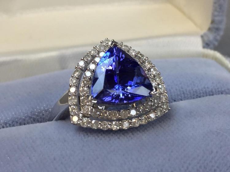 14k White Gold Tanzenite and Diamond ring (3.88ct tanzenite .90ctw diamonds) w/ $10,340.00 A.I.G. appraisal.