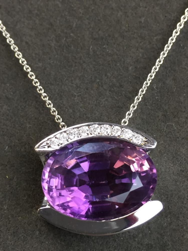 14k Gold Amethyst and Diamond pendant on 14k chain (13.01ct amethyst .14cts diamond) w/ $4,100.00 A.I.G. appraisal.