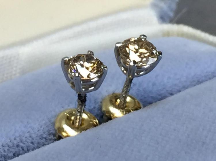 14k Gold and Diamond solitaire earrings with screw-on backplates (.73ctw diamonds) w/ $1,700.00 A.I.G. appraisal.