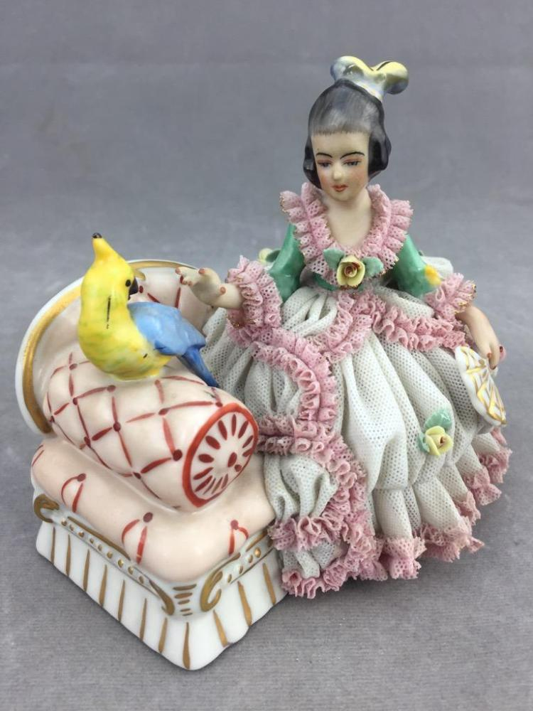 Beautifully detailed Frankenthal porcelain lady & bird figurine