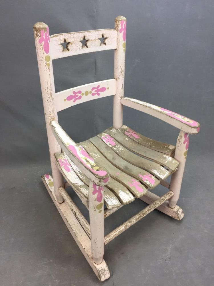 Antique child's rocking chair with original hand painted designs