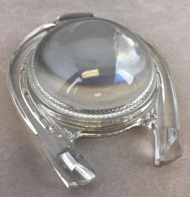 Antique magnifier glass with horseshoe design