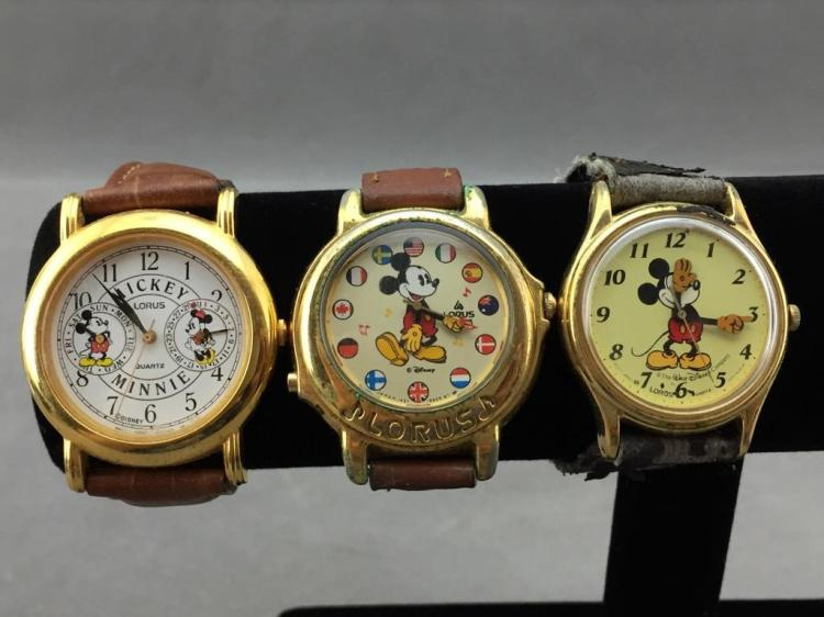 Lot of (3) vintage Disney Mickey Mouse watches with original straps, marked Lorus, Japan