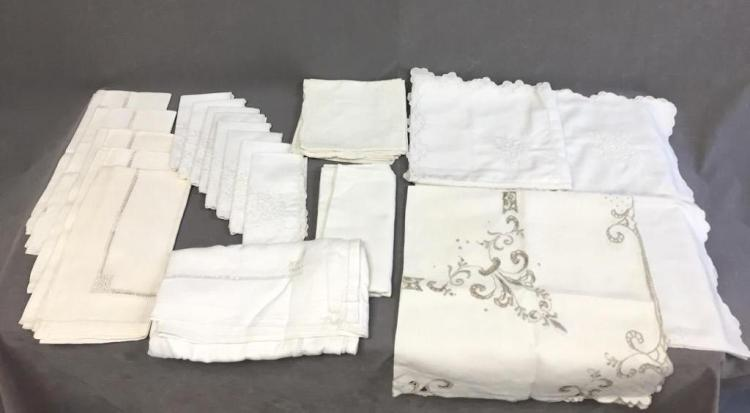 Assorted White linen napkins and tablecloths with various detailed trim styles and designs