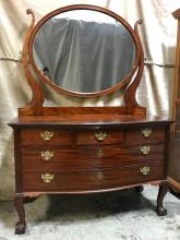 1900's Mahogany swivel mirrored dresser with claw feet. Manufactured by Lawrence