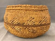 Early 1900s Shoshone Indian basket with stylized arrowheads all the way around