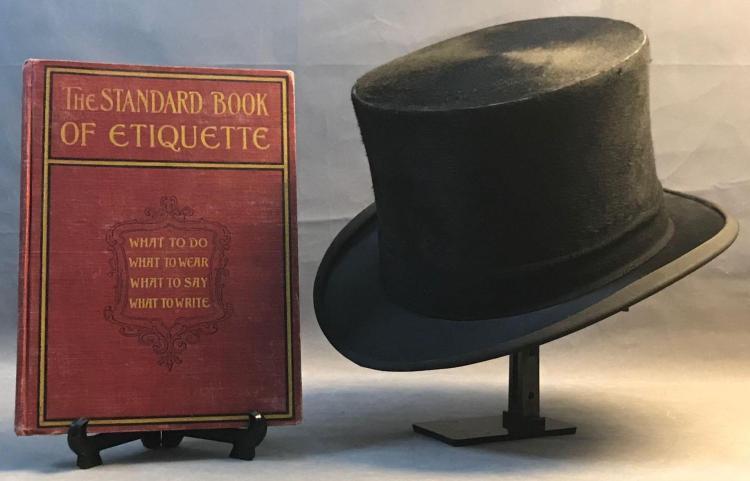 Antique silk fur top hat and The Standard Bookof Etiquette