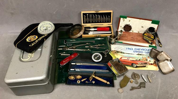 Fun container full of assorted man things, Keuffel and Esser Co. drafting tool kit, US Navy Navigato