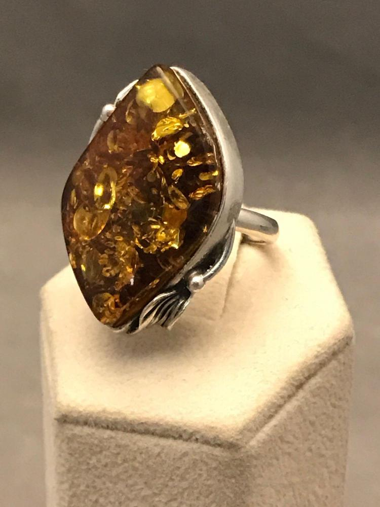 Modernist sterling silver an amber ring with delicate leaf detail