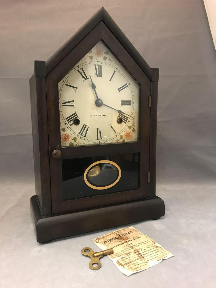 Antique Seth Thomas mantle clock with floral motif and key