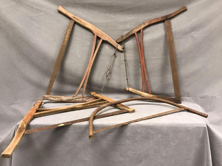 Lot of four antique hand saws, Bow Buck and more