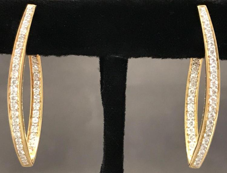 18 karat yellow gold and diamond inside out hoop earrings with hinged snap locking posts