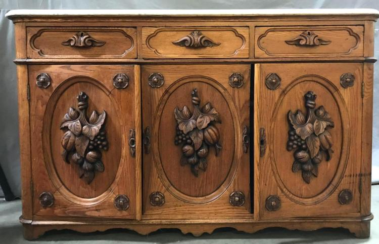 Antique highly carved marble topped three drawer, two door sideboard