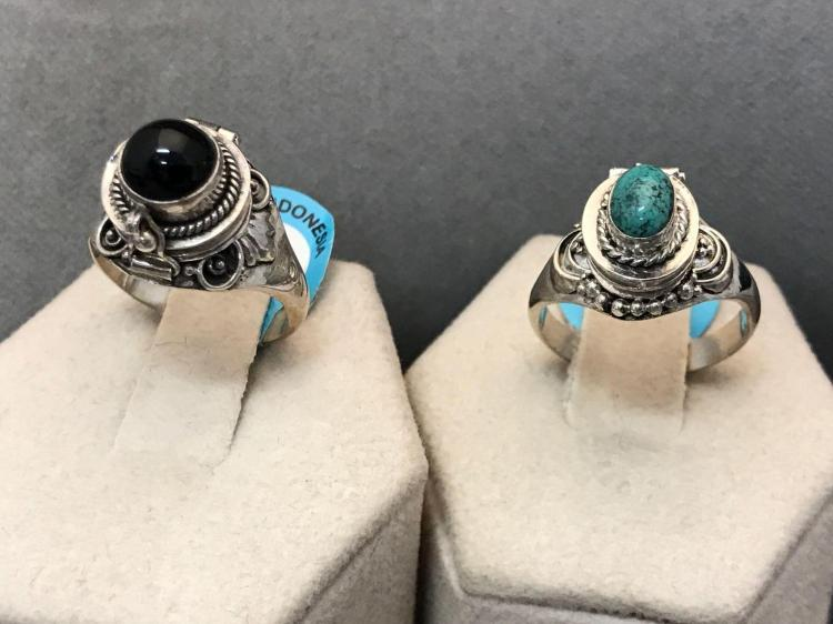 Two. Sterling silver poison rings with semi precious stones