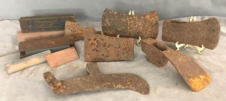 Lot of 6 axe and broad ax heads and 5 sharpening stones.