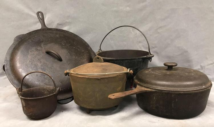 Five piece of antique cast iron kettles and skillets