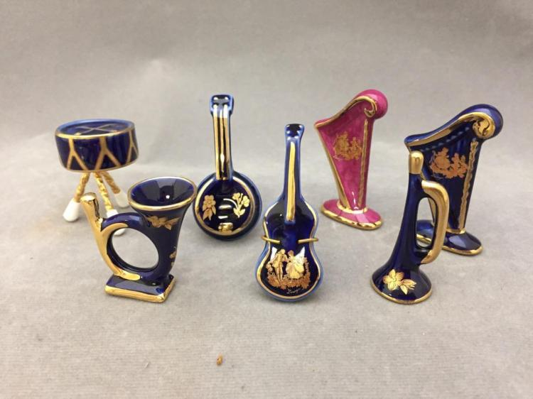 Lot of (20) Limoges France porcelain miniature instruments: harps, mandolins, trumpets, horns, guitars, & more