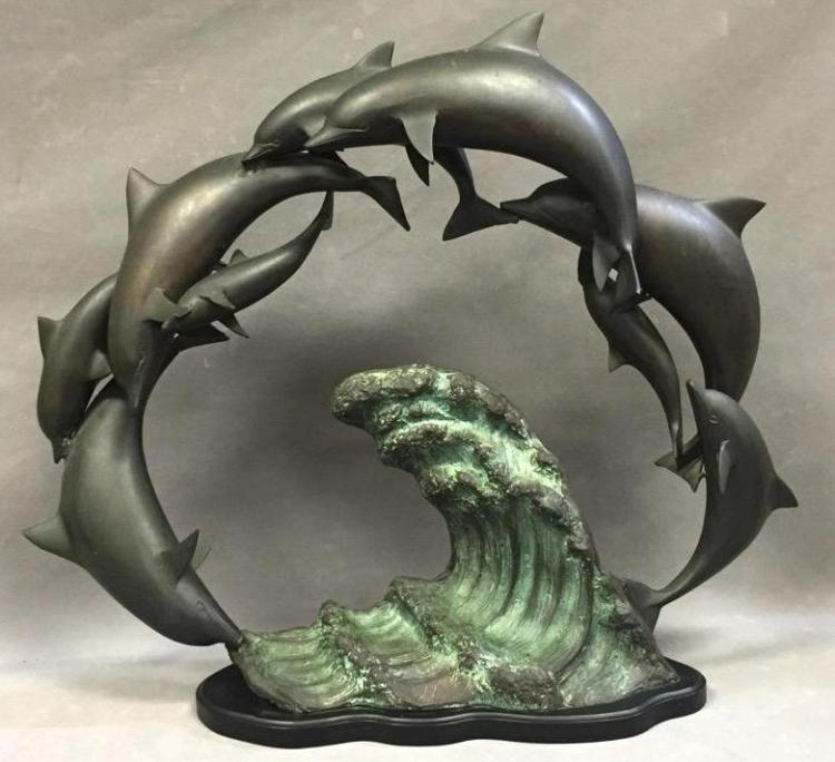 Large bronze dolphin sculpture, signed by artist