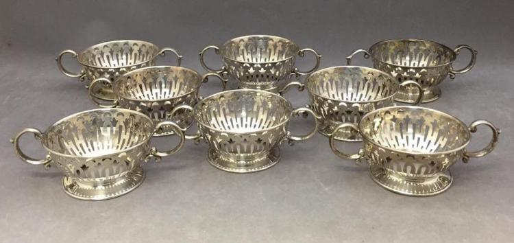 8 Sterling silver cup holders, 498g
