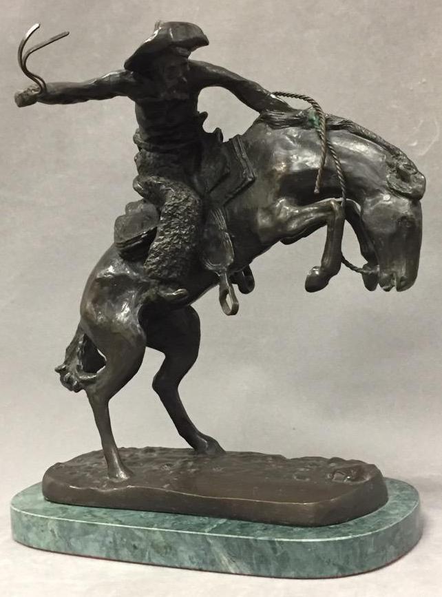 Bronze cowboy sculpture after Remington