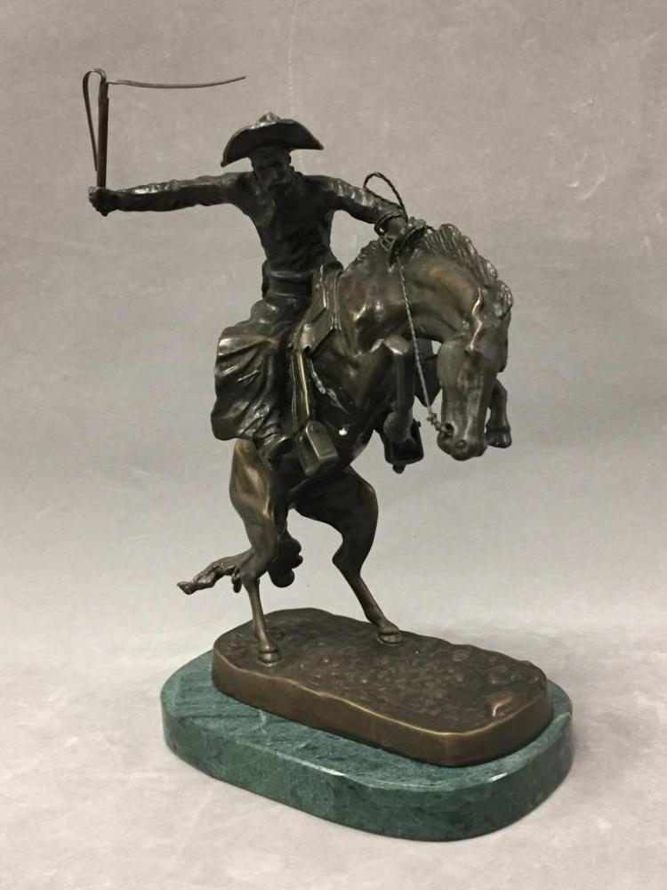 Bronze cowboy sculpture after Remington