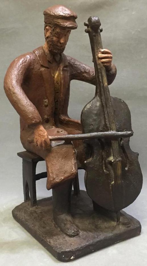 Austin Productions pottery sculpture of cellist