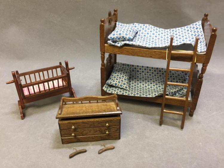 Lot of (3) dollhouse bedroom furniture: rocking cradle; bunk bed w/ pillows & ladder; blanket chest