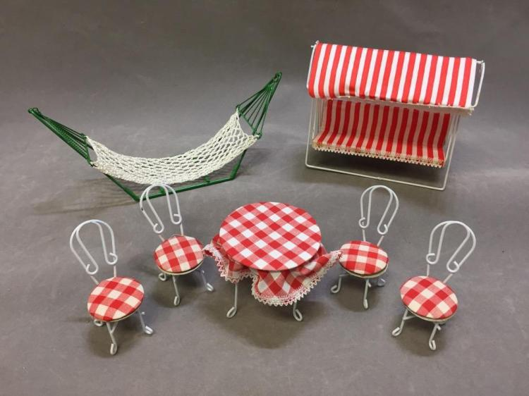 Lot of (7) dollhouse garden furniture: hammock; swing bench; table set w/ chairs