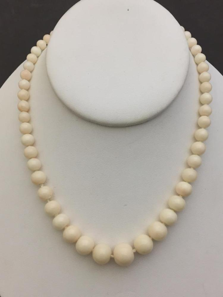 White coral necklace with 14k gold clasp