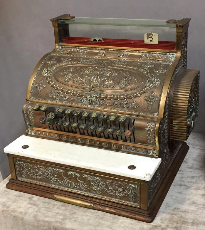Beautiful antique National cash register w/ornate brass body & oak base