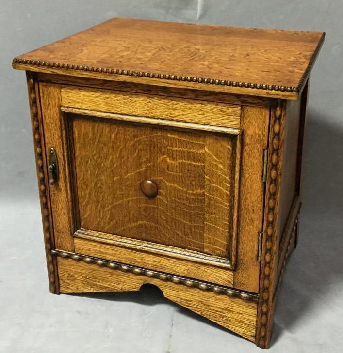 Antique tiger oak record cabinet, circa 1900, w/ hand-carved designs