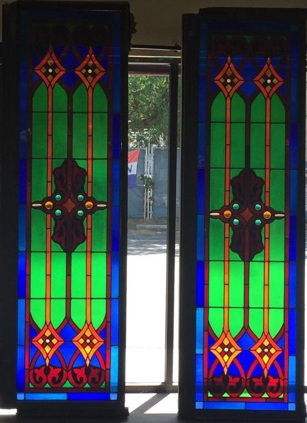 Pair Of Older Stained Glass Windows W Vibrant Patterns And Wooden
