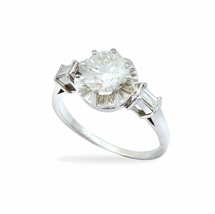 A platinum solitaire ring with diamond