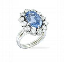 An 18kt white gold and natural sapphire ring