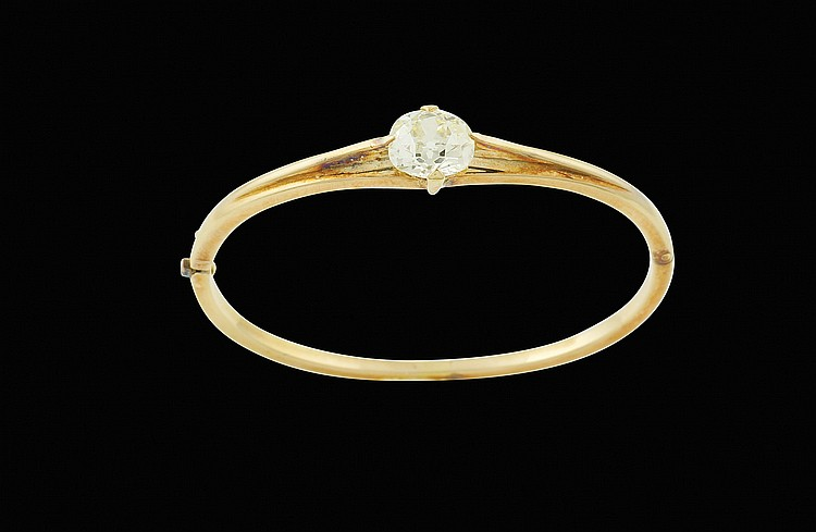 A pink gold bracelet with a diamond