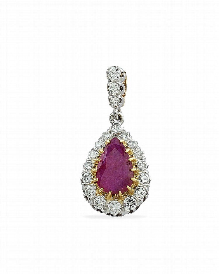 An 18kt two color gold pendant with natural ruby
