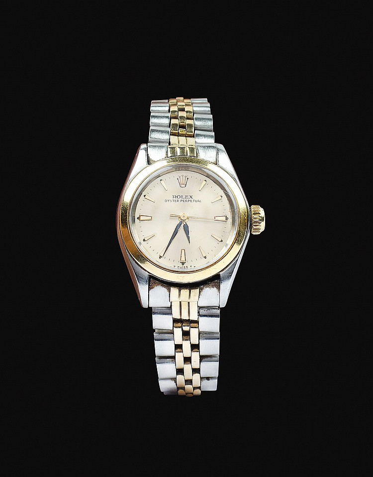 A Rolex Oyster Pertual Lady in gold and steels