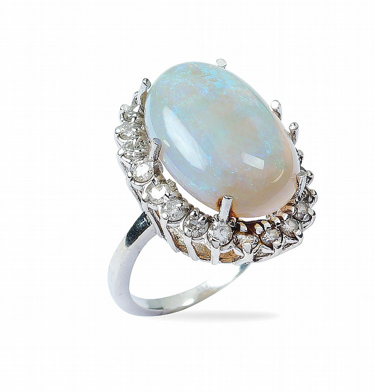 An 18kt white glod ring with harlequin opal
