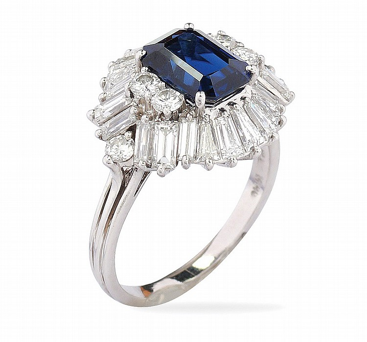 A platinum,diamond and natural sapphire ring
