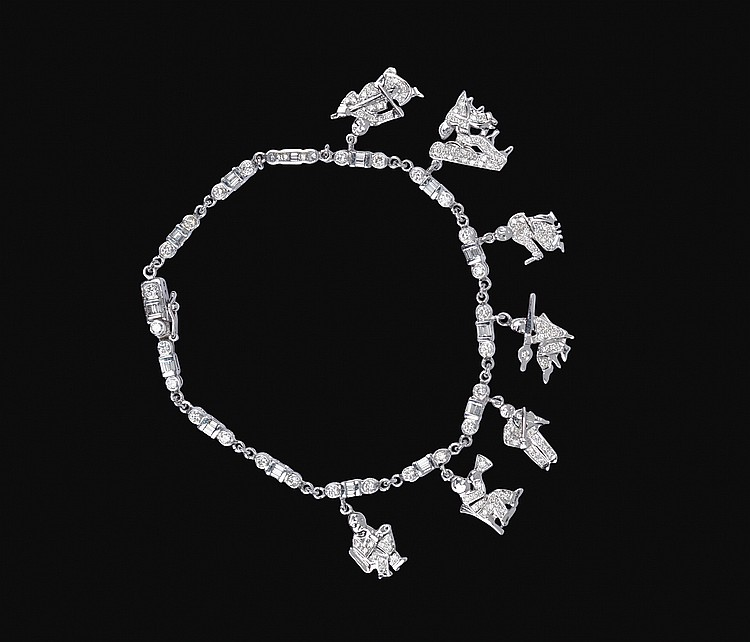 A 18kt white gold charms