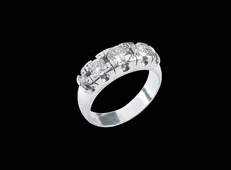 A platinum riviere ring with three diamonds