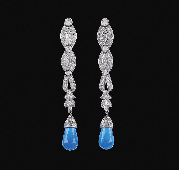 A pair of 18kt white gold pendant earrings with diamonds