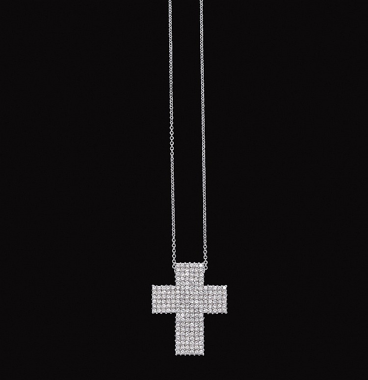 An 18kt white gold pendant cross with diamonds