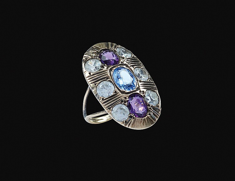 A gold, silver and colorful quartz ring