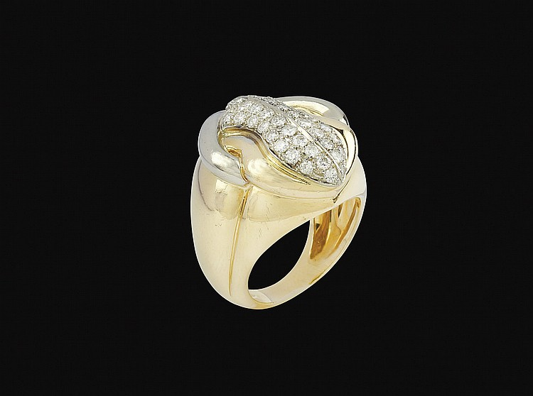 An 18kt white,yellow gold and diamond ring