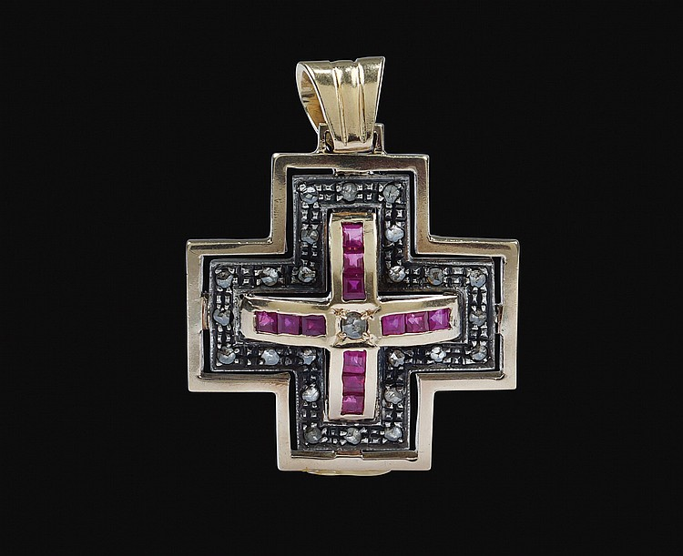 A pink gold and silver pendant cross