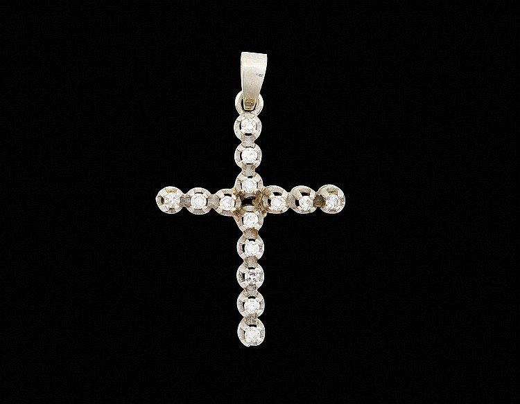 An 18kt white gold pendant cross